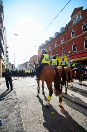 fascism: Sheffield, UK - June 8, 2013 - Mounted police cordon at English Defence League and United Against Fascism protest Editorial