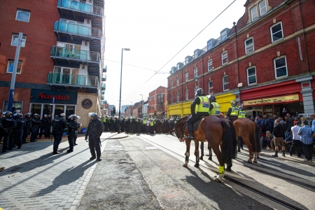 fascism: Sheffield, UK - June 8, 2013 - Mounted police and riot police cordon at English Defence League and United Against Fascism protest Editorial