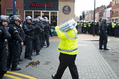 fascism: Sheffield, UK - June 8, 2013 - Riot police receiving water at English Defence League and United Against Fascism protest