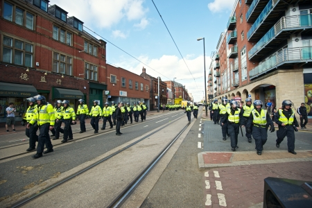 fascism: Sheffield, UK - June 8, 2013 - Riot police returning to their vehicles after English Defence League and United Against Fascism protest