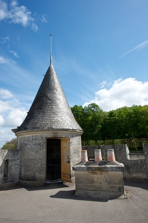 Old triangular roof against blue skies at France chateau