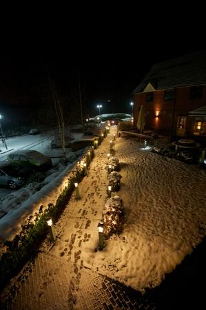 carpark: Quiet path on a snowy night Stock Photo