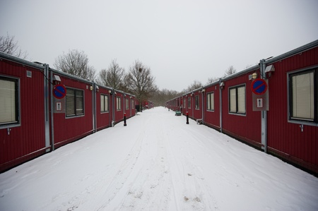 dormitory: Gloomy container housing in winter Stock Photo