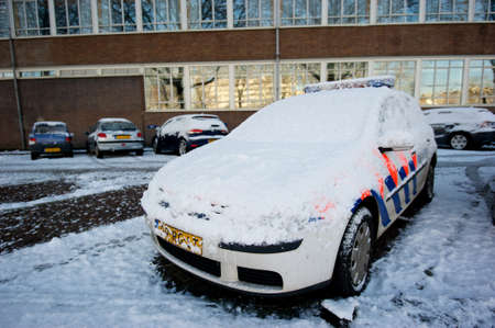 Police car covered in snow Editorial