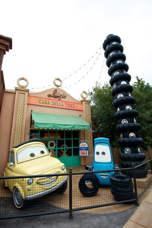 Smiling cars at an amusement park waiting for guests