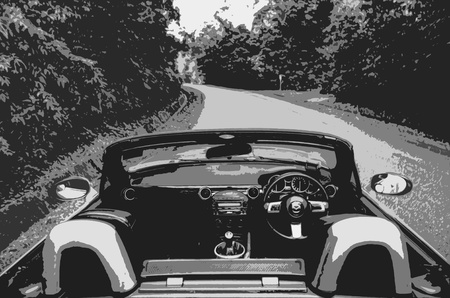 Topless roadster alone on a quiet road