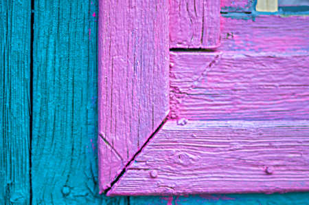 Details of an old painted wooden window frame and the wall of the guesthouse in the garden Stock Photo