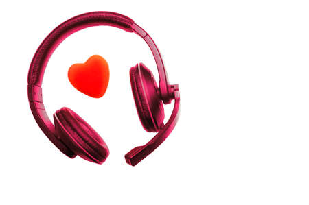 Violet Red Headset, Headphones with Microphone and Red Heart Isolated On White Background.  Call Center, Technical Support, Love, Valentines Day, Medicine, Music Concept.