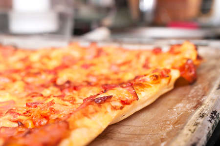 Freshly Baked and Hot Pizza on a Sheet Pan.