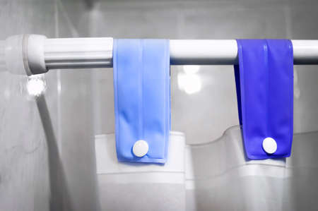 Shower Curtain Rod, Blue Fabric Loops, White Buttons and Shower Curtain.