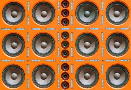 Multiple Rows of Sound Speakers, Led Light Strips on Orange Background. Stock Photo