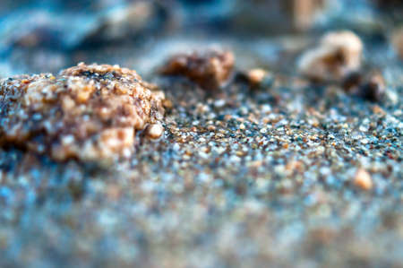 Close-up View of Wet Coarse Sand. Travel Concept.