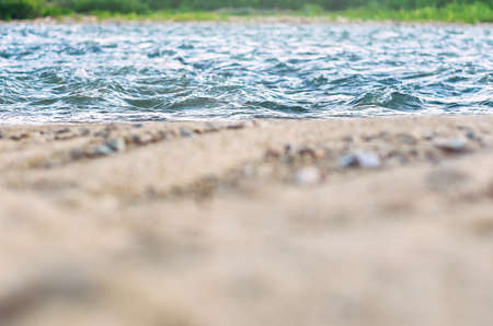 Low Angle View of Fast River Waves, Wet Coarse Sand, Pebble. Stockfoto