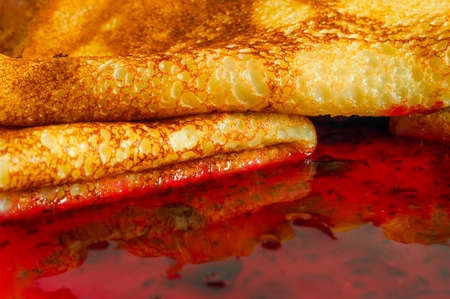 Close-up View of Stacked Pancakes and Jam on the Plate.
