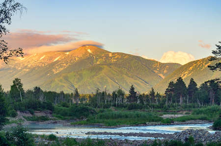 Mountain river and forest trees on the sunset, Altai Mountains, Kazakhstan. Stock fotó