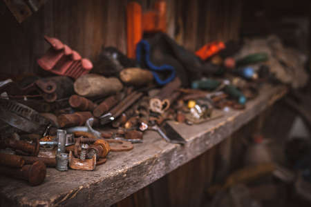 Perspective View of a Messy Wooden Shelf in a Garage Workshop. Keeping Your Workspace Clean and Tidy Concept. Reklamní fotografie