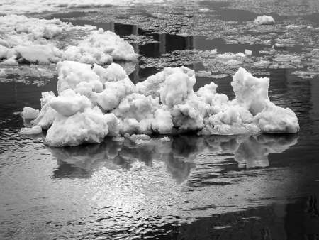 Black and White Image of Snow Pile and Frazil Ice in the Water.