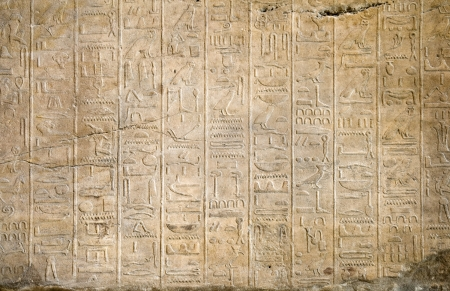 Stone wall with an Egyptian hieroglyphs photo