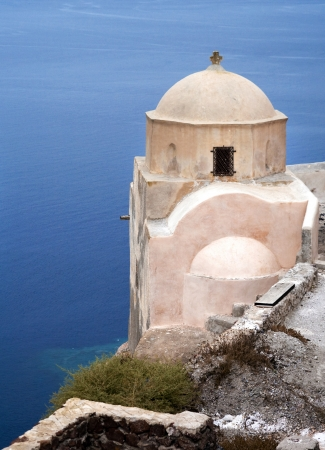 Small church with sea on background on Santorini island, Greece  photo