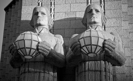 Granite statues of Helsinki central railroad station photo
