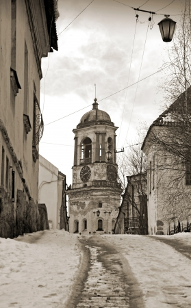 vyborg: Street with tower in Vyborg  old town in Russia  Vintage stylized photo