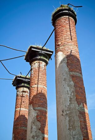petrovich: Abandoned landmark  pillars of old military quarters  Was built in 6 years from 1818  Architect - Vasily Petrovich Stasov  Selishi village, Novgorod region, Russia Stock Photo