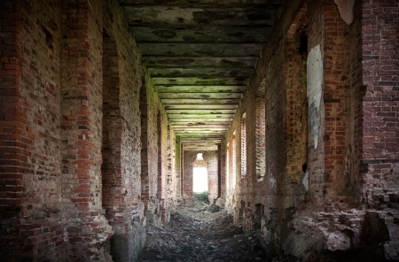 petrovich: Abandoned landmark interior with dark corridor  ruins of old military quarters  Was built in 6 years from 1818  Architect - Vasily Petrovich Stasov  Selishi village, Novgorod region, Russia
