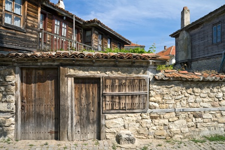 builds: Street with stone walls and wooden builds in ancient town Nessebur, Bulgaria