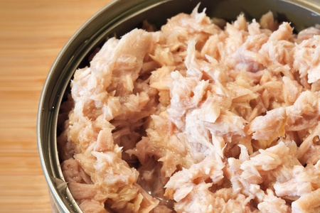 Minced tuna in the can closeup photo photo