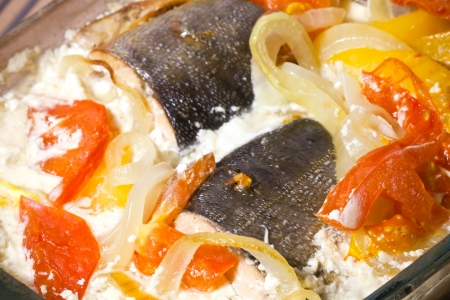 dog salmon: Seafood theme  Pink salmon baked in cream with vegetables closeup photo