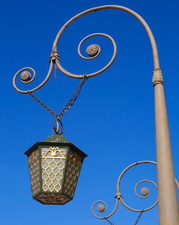 Vintage street lantern on the bridge in Saint-Petersburg, Russia. Stock Photo - 15553253