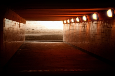 Underground passage with lights and stairs in glowing end Stock Photo - 15553269