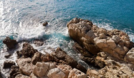 France, Nice  breaking waves with rocks photo