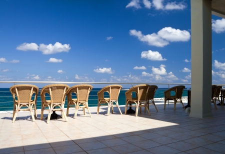 The row of free wicker chairs on the seaside terrace  Greece, Crete  photo
