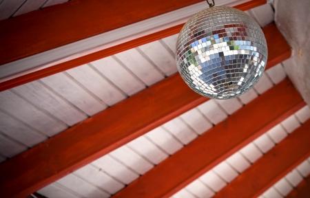 disco mirrorball: Disco mirror-ball on the beach club ceiling