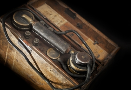 Vintage weathered military telephone from WWII period photo