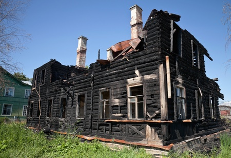 charred: Burnt old wooden building in Russia