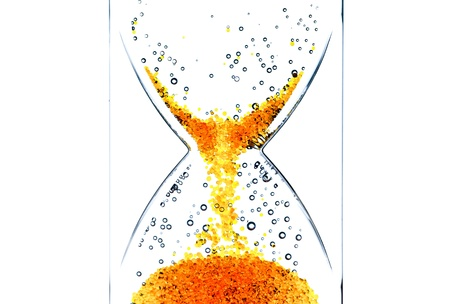 Hourglass with a red bubbles photo