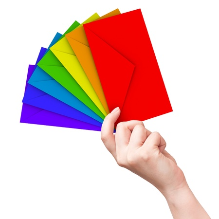 communicate  isolated: Colorful envelopes in the female hand isolated on white background