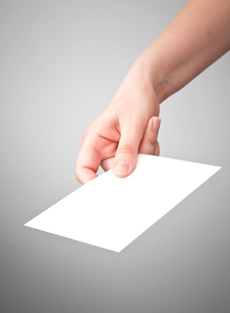 postman: Female hand with the white virtual card on gray background