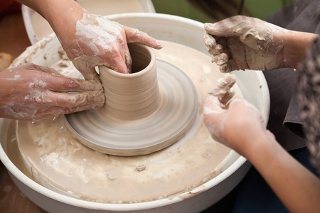 artisanal: Pottery masterclass with throwing wheel Stock Photo