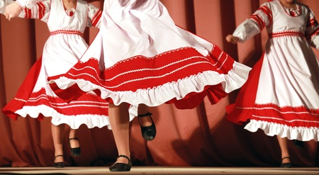 waved: Bright fragment of fast Russian folk dance with red-white girls waved skirt Stock Photo