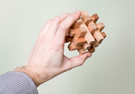 man s: Wooden puzzle in a man s hand