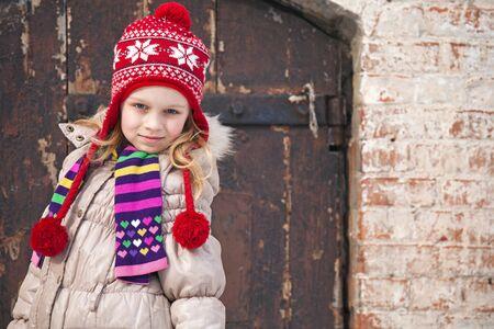 outwear: Little girl wearing colorful winter outwear