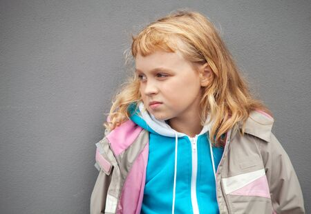 sport clothes: Little blond girl wears casual sport clothes   Stock Photo