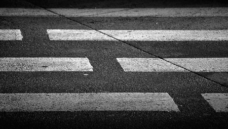 Pedestrian crossing with road marking  white rectangles on the dark asphalt road  photo