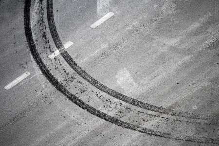 squeal: Abstract road background with crossing of road marking and tires track