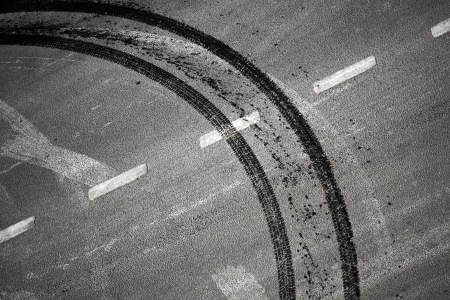 Abstract road background with crossing of road marking and tires track Stock Photo - 15658709