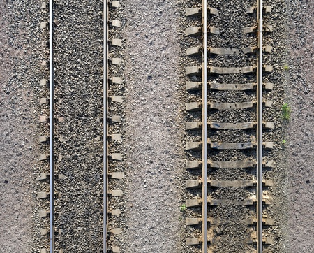 Detailed industrial background texture of railway tracks on gravel Stock Photo - 15658683
