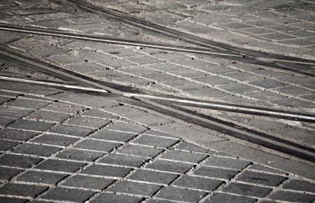 Street railway point on granite cobblestone road photo